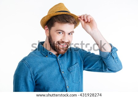 Close-up portrait of a smiling handsome man with a hat isolated on the white background