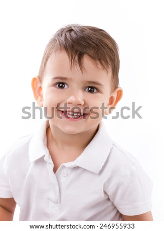 close-up portrait of a smiling little boy in white shirt on white background