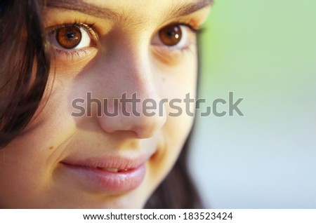 Close-up portrait of a smiling little girl - stock photo