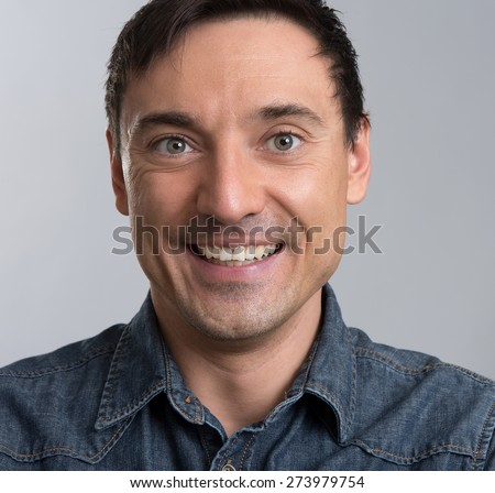 close up portrait of a smiling man - stock photo