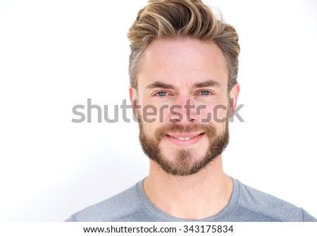 Close up portrait of a smiling man with beard posing against isolated white background  - stock photo