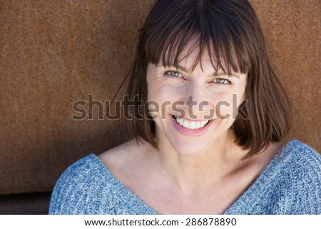Close up portrait of a smiling middle aged woman - stock photo