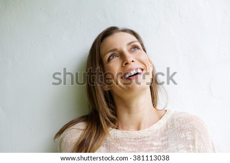 Close up portrait of a smiling older woman looking up - stock photo