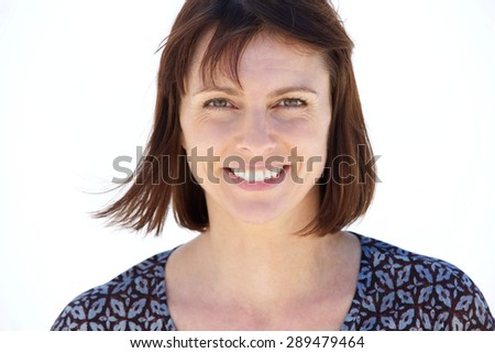 Close up portrait of a smiling older woman on isolated white background - stock photo