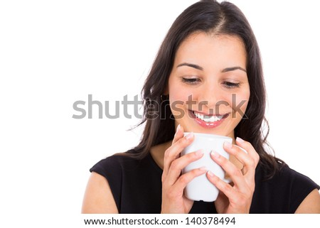 close-up portrait of a smiling woman holding a cup of coffee