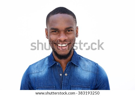 Close up portrait of a smiling young african american man in a denim shirt against white background  - stock photo