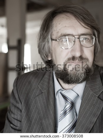 Close up portrait of a successful senior business man  - stock photo