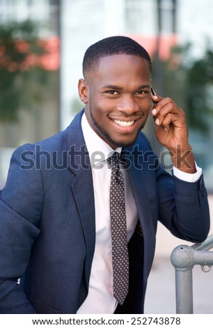 Close up portrait of a successful young businessman calling by mobile phone - stock photo