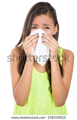 Close-up portrait of a teen woman with allergy or cold, isolated on white background - stock photo