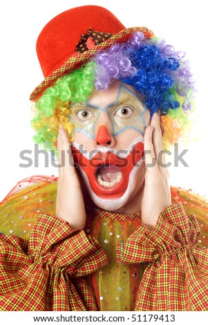 Close-up portrait of a terrified clown. Isolated on white