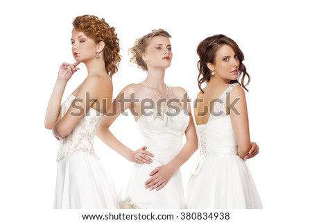 Close Up, Portrait of a three beautiful woman in wedding dress isolated over white background - stock photo