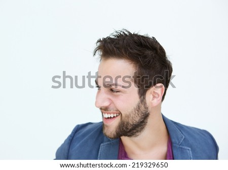 Close up portrait of a trendy young man smiling on white background  - stock photo