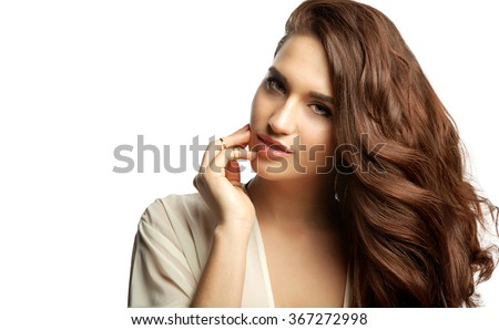 Close-up portrait of a woman with long thick dark hair on a white background - stock photo
