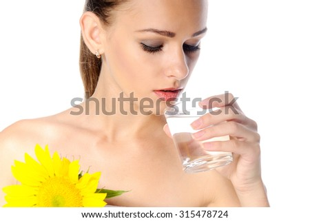 Close-up portrait of a woman with sunflowers that drinking water on an isolated background - stock photo
