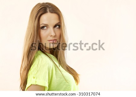 Close up portrait of a young adult attractive sexy and sensuality pretty woman with beautiful blond hairs and yellow shirt isolated on white background - stock photo