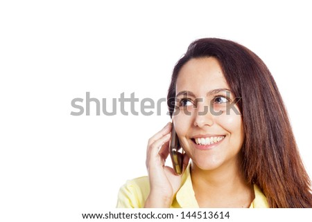 Close-up portrait of a young beautiful woman talking on the phone, isolated over white - stock photo