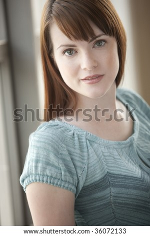 Close-up portrait of a young brunette woman - stock photo
