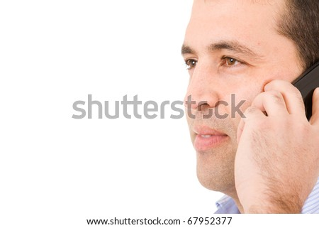 Close-up portrait of a young casual man on the phone. Isolated on white - stock photo