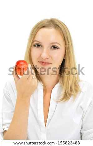 Close-up portrait of a young female eating an apple - stock photo