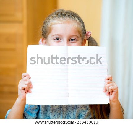 Close up portrait of a young girl holding blank sign - stock photo