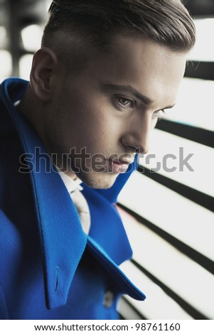 Close up portrait of a young guy - stock photo
