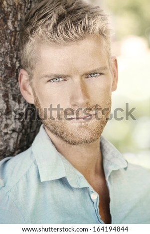 Close up portrait of a young handsome male model face - stock photo