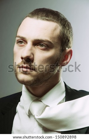 close-up portrait of a young man, shot in studio - stock photo