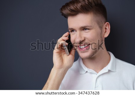 close-up portrait of a young man talking on his mobile phone