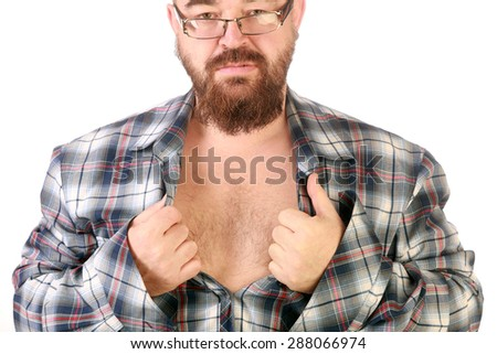 close-up portrait of a young man with a beard and mustache, tearing his shirt on his chest - stock photo