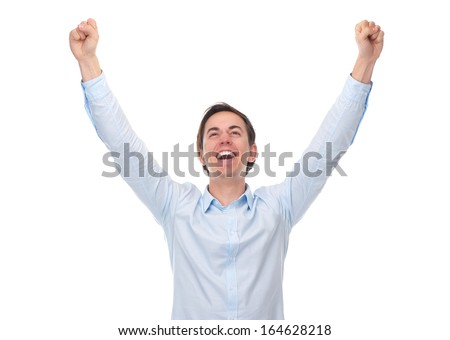 Close up portrait of a young man with arms raised in celebration isolated on white background - stock photo