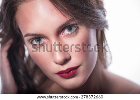 Close-up Portrait of a young pretty girl. Fresh skin and red lips. Large green eyes in focus, isolated on white background - stock photo