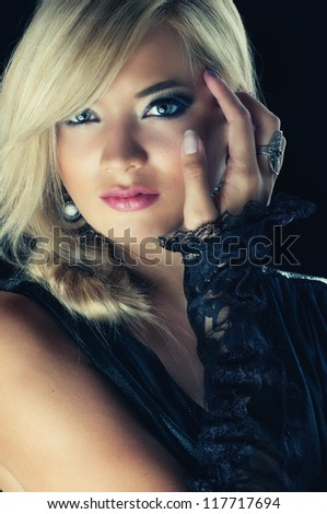 Close-up portrait of a young sexy blond woman, studio shot - stock photo