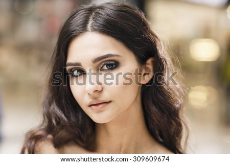 Close up portrait of a young stylish woman