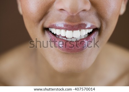 Close-up portrait of a young woman looking down - stock photo