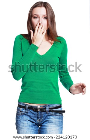 Close-up portrait of a young woman scared and afraid with wide opened eyes isolated on a white background  - stock photo