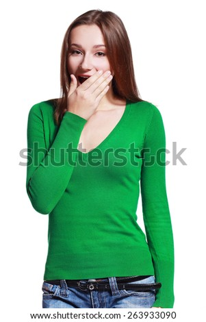 Close-up portrait of a young woman scared or surprised with wide opened eyes isolated on a white background - stock photo