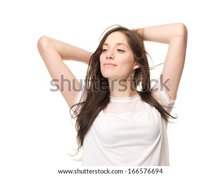 Close up portrait of a young woman with hand in hair and looking away, isolated on white background