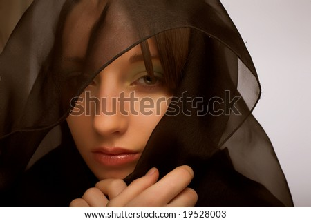 Close-up portrait of a young woman with mourning veil - stock photo