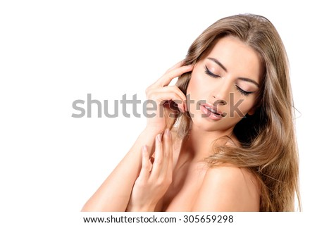 Close-up portrait of a young woman with pure fresh skin and beautiful healthy hair. Youth and beauty. Skincare, haircare, Spa. Isolated over white. - stock photo