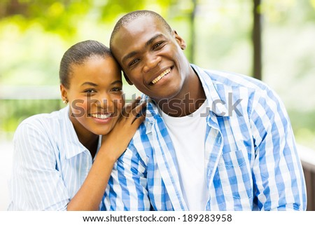 close up portrait of african american couple outdoors - stock photo