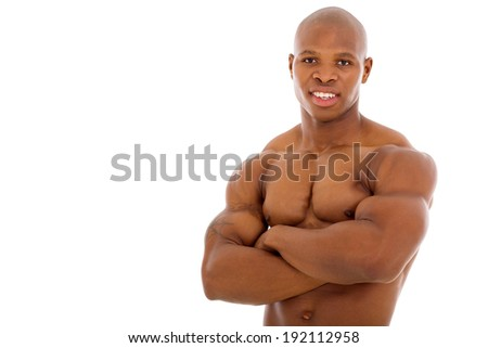 close up portrait of african bodybuilder with arms crossed