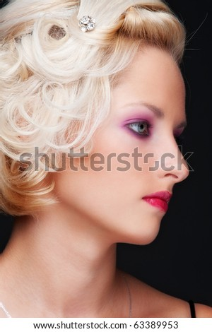 close-up portrait of alluring blonde with hairdo - stock photo