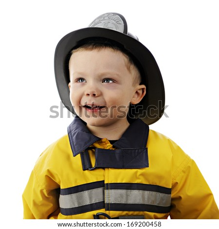 Close-up portrait of an adorable 2-year-old in his fireman's outfit.  On a white background.