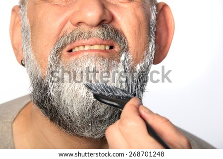close-up portrait of an adult male color beard and mustache on white background studio