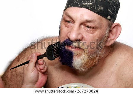 close-up portrait of an adult male in bandana when dyeing beards and mustache on white background studio - stock photo