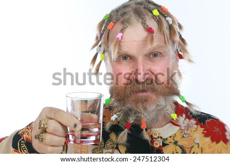 close-up portrait of an adult male with a beard, mustache and a variety of braids with a glass in hand on white background studio