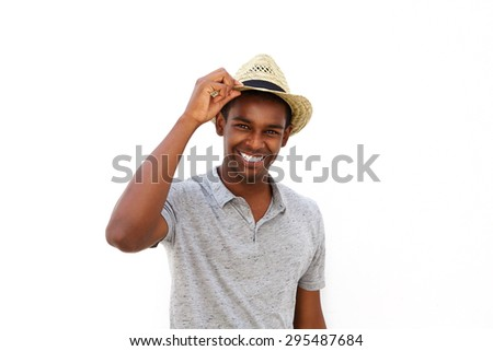 Close up portrait of an african american male fashion model smiling with hat  - stock photo