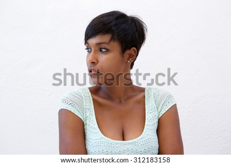 Close up portrait of an attractive african american woman with short hairstyle - stock photo