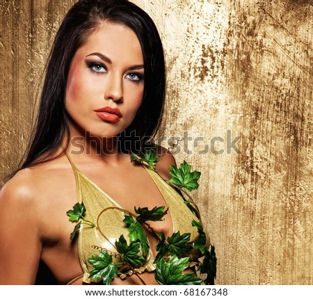 Close-up portrait of an attractive brunette woman - stock photo