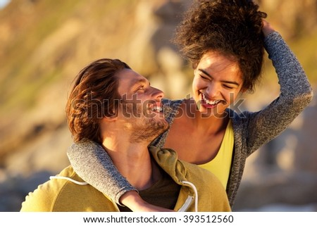 Close up portrait of an attractive couple laughing together - stock photo